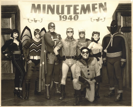 "Still photo of the Minutemen, the original 1940s superhero group in ""Watchmen"""